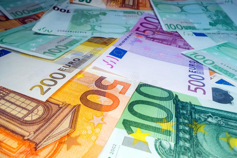 Wide angle view of euro notes background stacked on top of each other. Euro money banknotes, pile of money, cash, stack of bills. royalty free stock photography