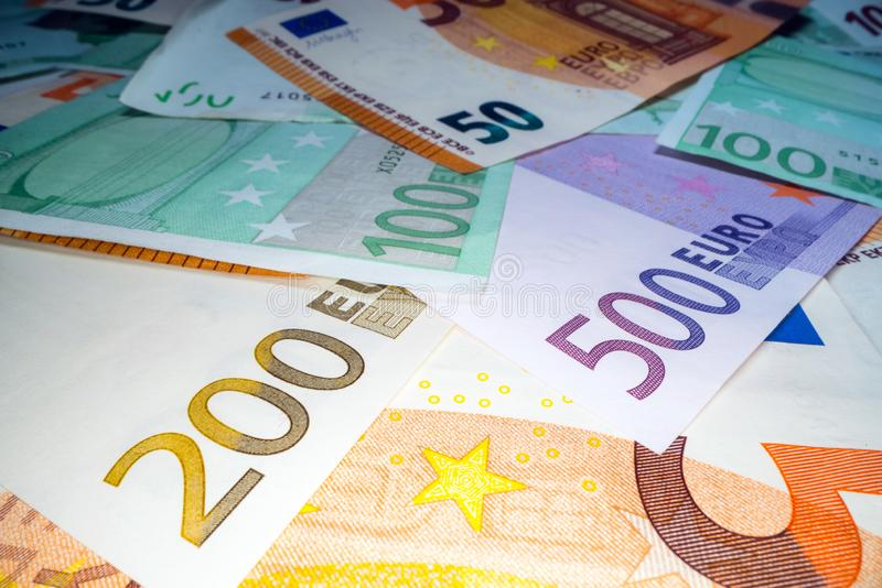 Wide angle view of euro notes background stacked on top of each other. Euro money banknotes, pile of money, cash, stack of bills. stock image