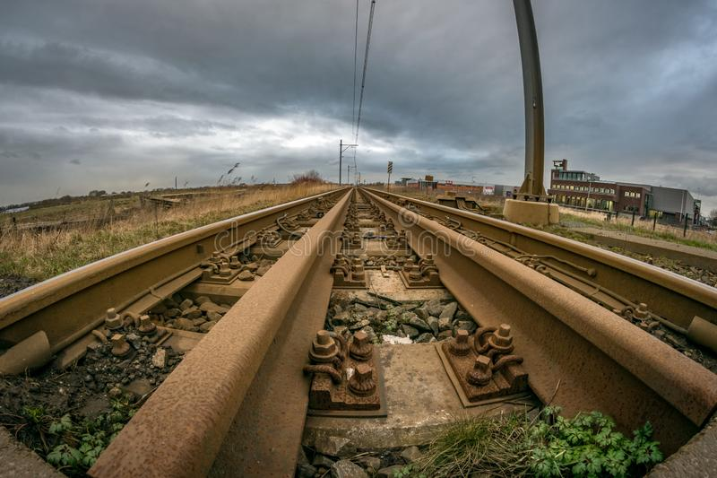 Wide angle view of a rusty railroad leading into the distance stock image