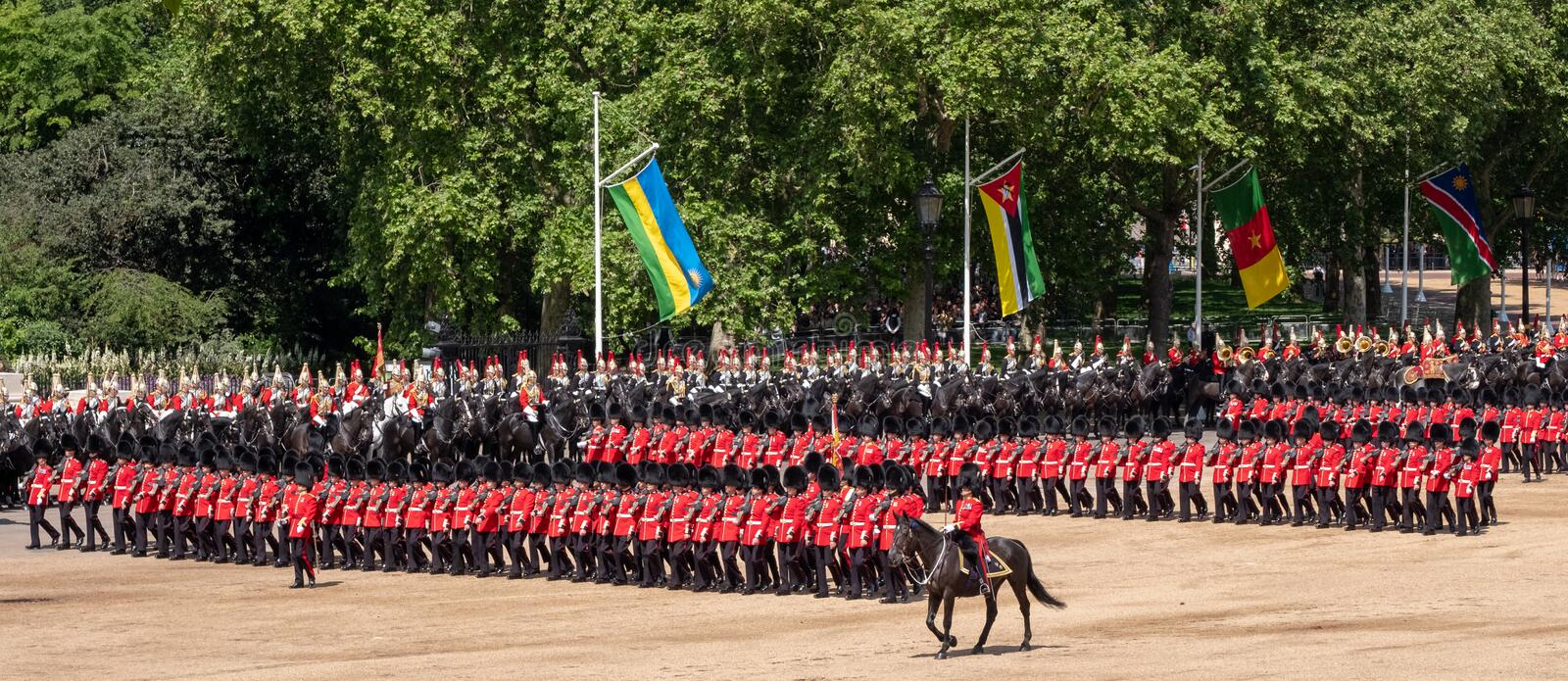 Wide angle view of the Trooping the Colour military parade at Horse Guards Parade, London UK, with Household Division soldiers. stock images