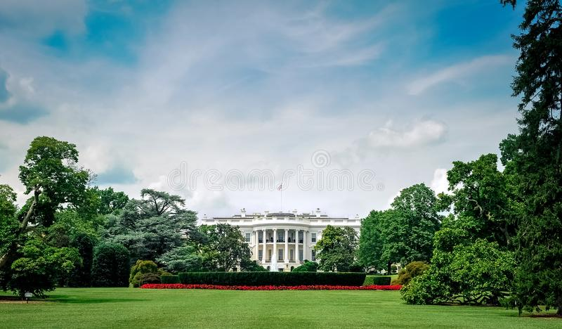 Washington D.C./Columbia/USA - 07.11.2013: Wide angle view at the White House with blue sky and clouds above. royalty free stock photo