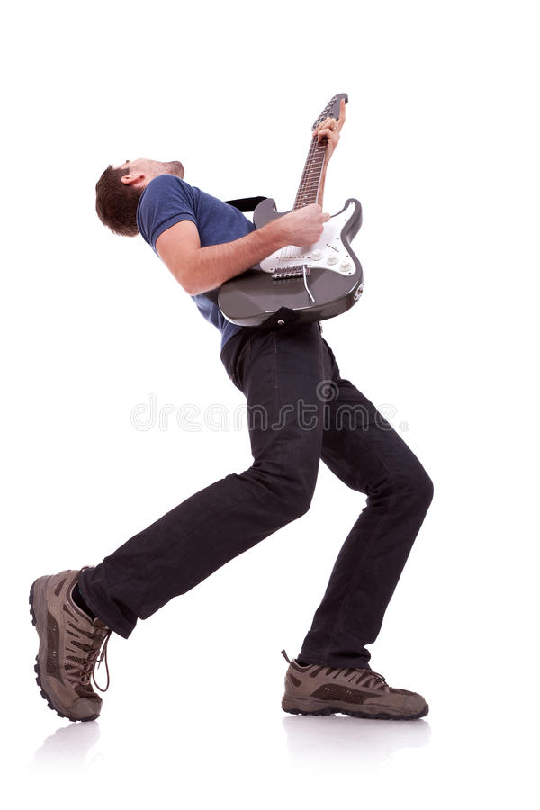Wide angle of a young guitarist. Playing on white baclground royalty free stock photo