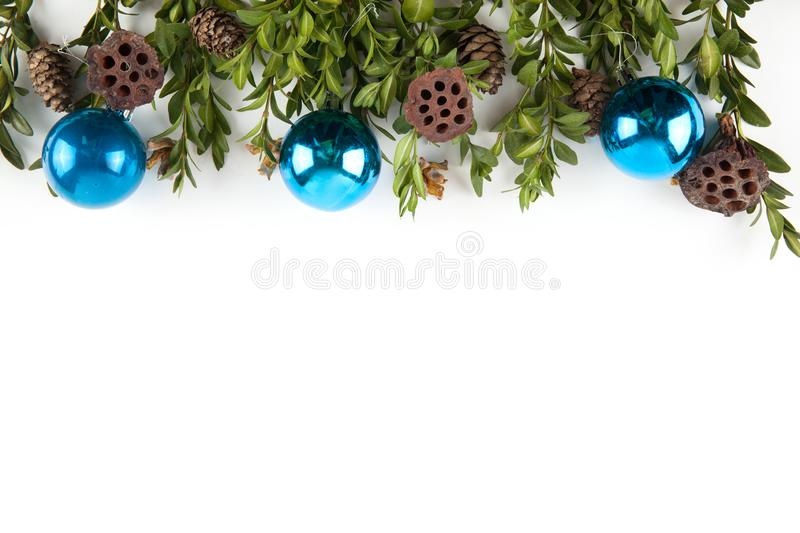 Wide arch shaped Christmas border isolated on white. Composed of fresh fir branches and ornaments in red and silver royalty free stock image