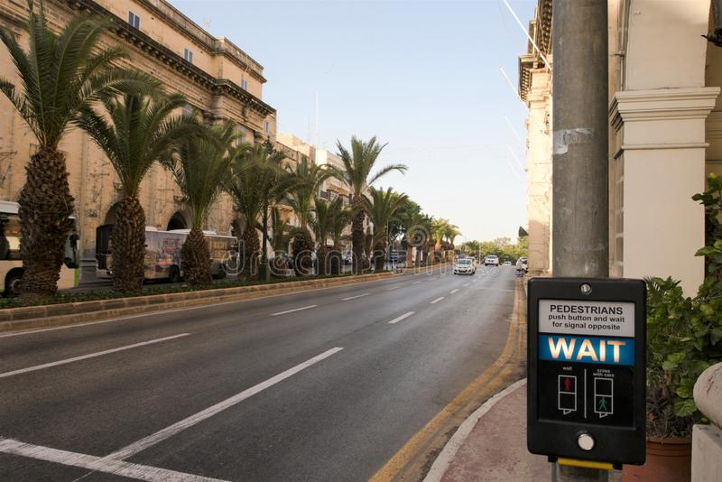 Floriana, Malta, August 2019. View of the main street of the city in the early morning. The only wide avenue on the island, three lanes in one direction, a stock images