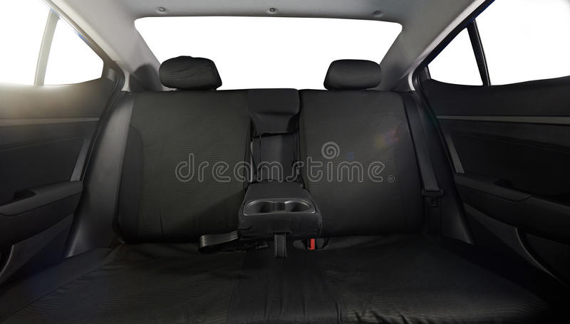 Wide back car seat. Wide cloth back modern car seat with isolated windows royalty free stock photography