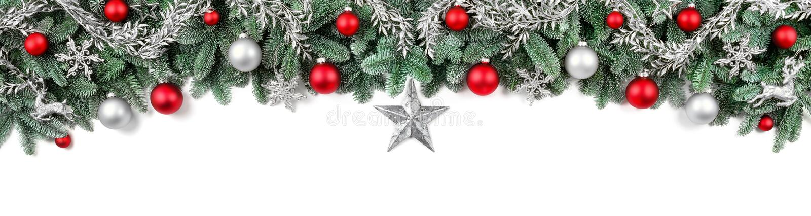 Wide bow-shaped Christmas border. Wide arch-shaped Christmas border isolated on white, composed of fresh fir branches and ornaments in red and silver royalty free stock photography