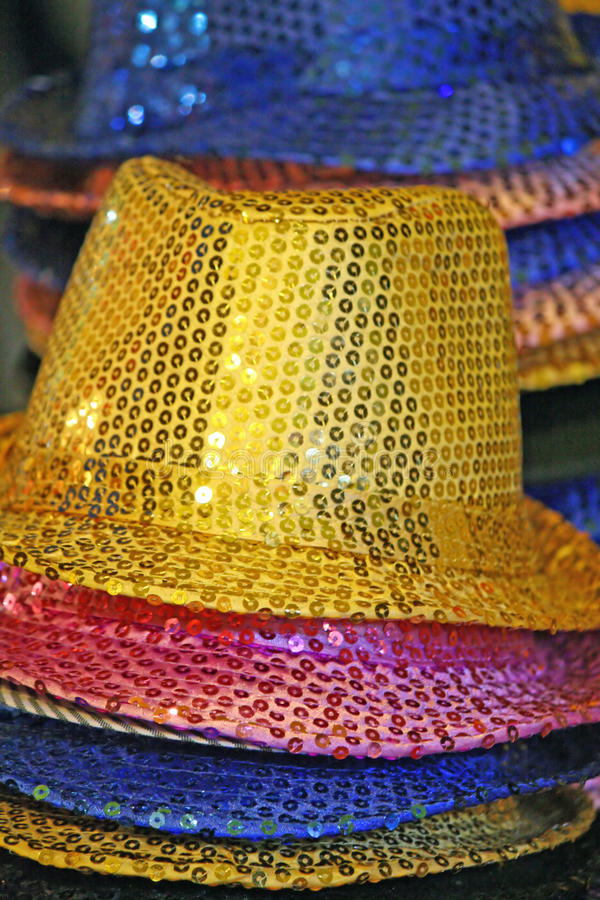 Wide-brimmed hats with colored rhinestones
