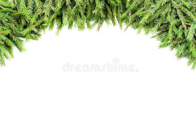 Wide Christmas border garland arranged with fresh fir branches isolated on white in arch form stock photos