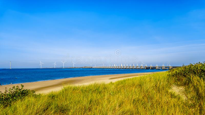 The wide and clean sandy beach at Banjaardstrand along the Oosterschelde. Inlet at the Schouwen-Duiveland peninsula in Zeeand Province in the Netherlands. The royalty free stock photo