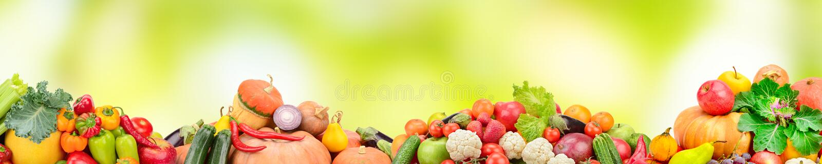 Wide collage of fresh fruits and vegetables on green blur background. stock illustration