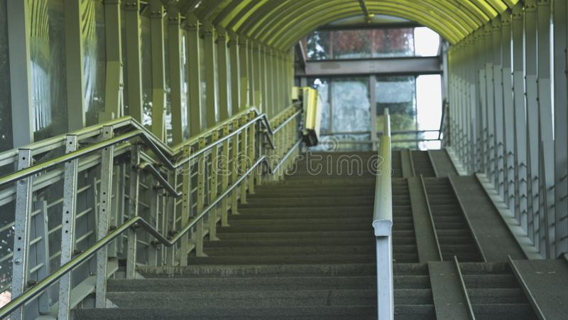 Wide concrete stirway with metallic ramp and railing royalty free stock photos