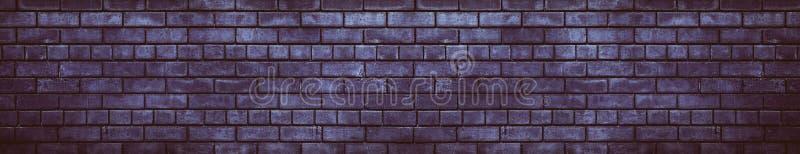 Wide dark violet brick wall gloomy grunge background stock photo