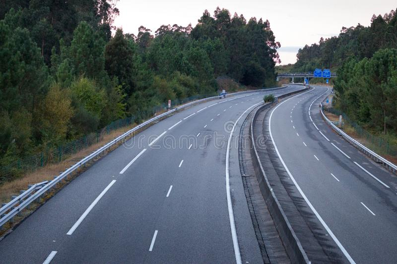 Wide empty highway with curve in the morning. Travel and destination background. Free asphalt road background. Motion and speed concept. Trip and journey stock photos