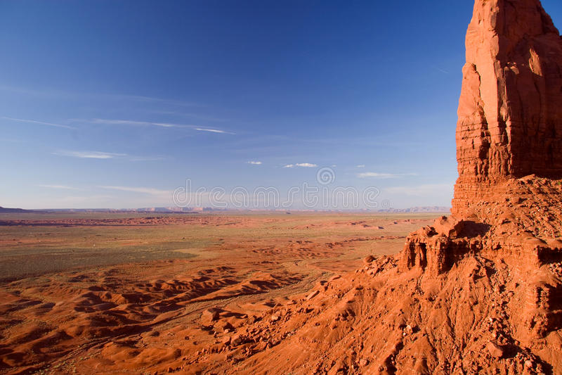 Wide expanses of Monument Valley with Spearhead Mesa on the right stock photo
