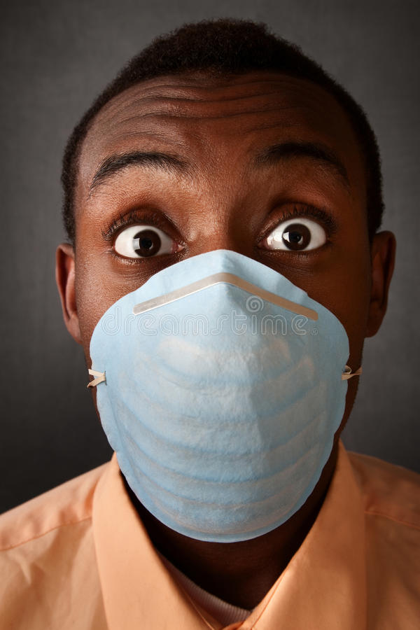 Wide-eyed man in surgical mask royalty free stock photo