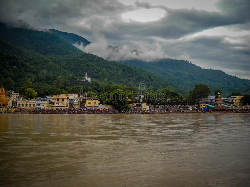Wide ganga river at rishikesh india, ganga river with hills & clouds, ganga river view. Wide ganga river at rishikesh india, ganga river with hills & clouds royalty free stock images