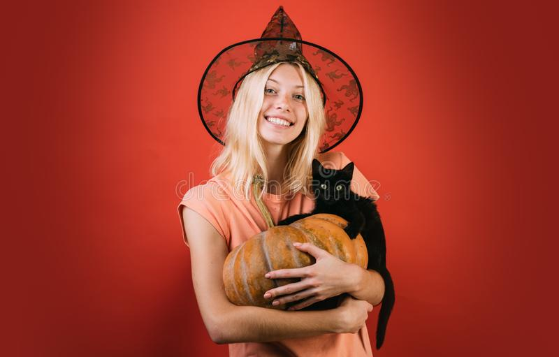 Wide Halloween party art design. Black cat with pretty girl. Close-up portrait of gorgeous happy blonde fairy stock photo