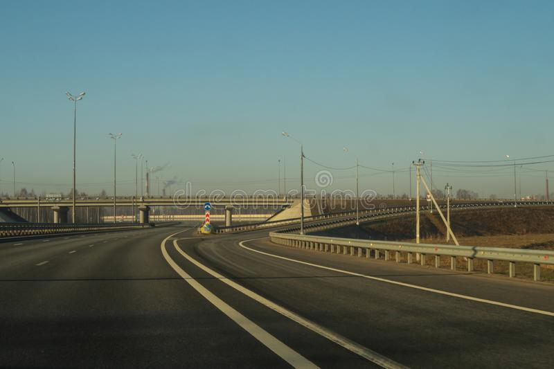 Wide highway. long roadway. road going into the distance. Wide highway. long roadway background. road going into the distance, aasphalt, barrier, bridge, car royalty free stock photos
