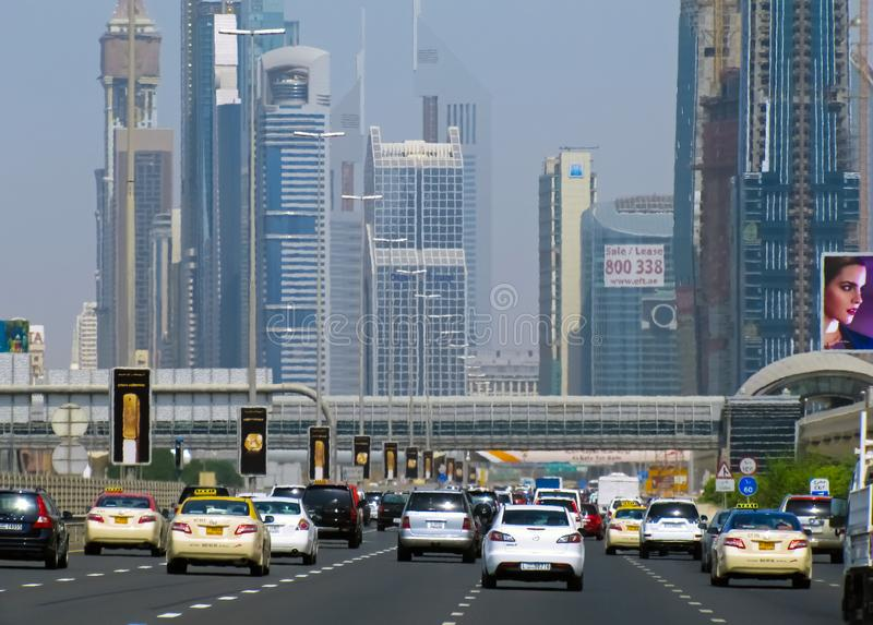 Wide highway to the city of Dubai. stock photos