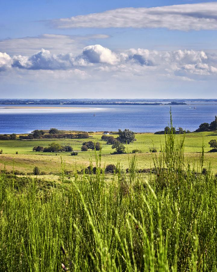 Wide Landscape and Baltic Sea with clouds on the island Hiddensee. Meadow, nature, baltic-sea-island, mecklenburg-vorpommern, panorama, summer, ozean stock image