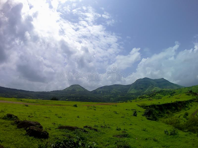 Wide landscape at Bhivpuri in Maharashtra, India. Lush green wide landscape at Bhivpuri located in Karjat, Maharashtra, India stock photos