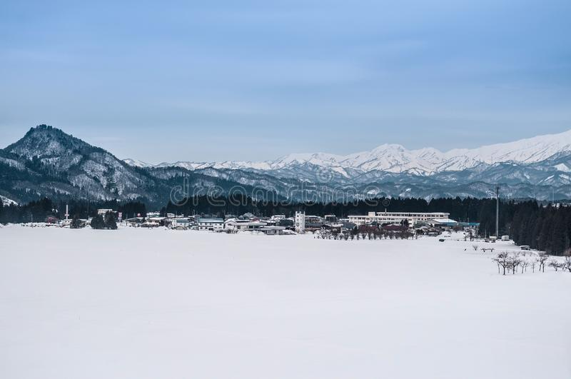 Wide landscape of small village and mountain range in Fukushima, Tohoku, Japan in Winter time landscape stock photography