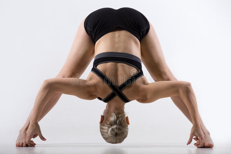 Wide Legged Forward Bend Pose stock images
