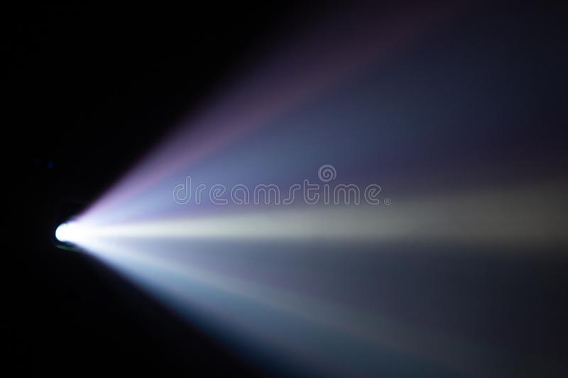 Wide lens light beam for movie and cinema at night . smoke texture spotlight . black background for multimedia.  stock photo