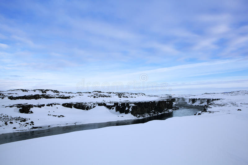 Wide lens panorama shot of waterfall Selfoss, Iceland. In wintertime royalty free stock photo