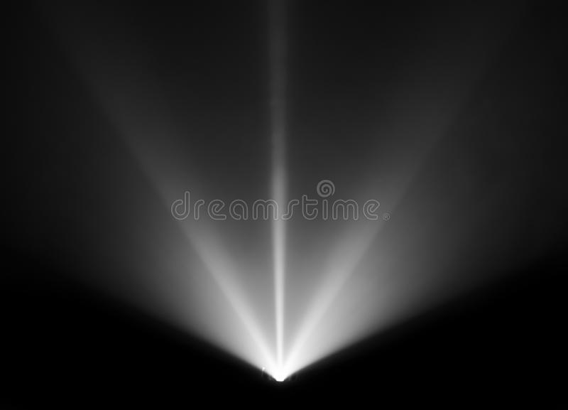 Wide lens projector with black and white light beam for movie and cinema at night . smoke texture spotlight . screening for. Multimedia . black background stock image