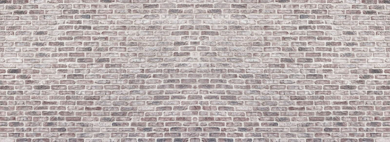 Wide red shabby brick wall texture. Old masonry panorama. Whitewashed rough brickwork panoramic vintage background royalty free stock images
