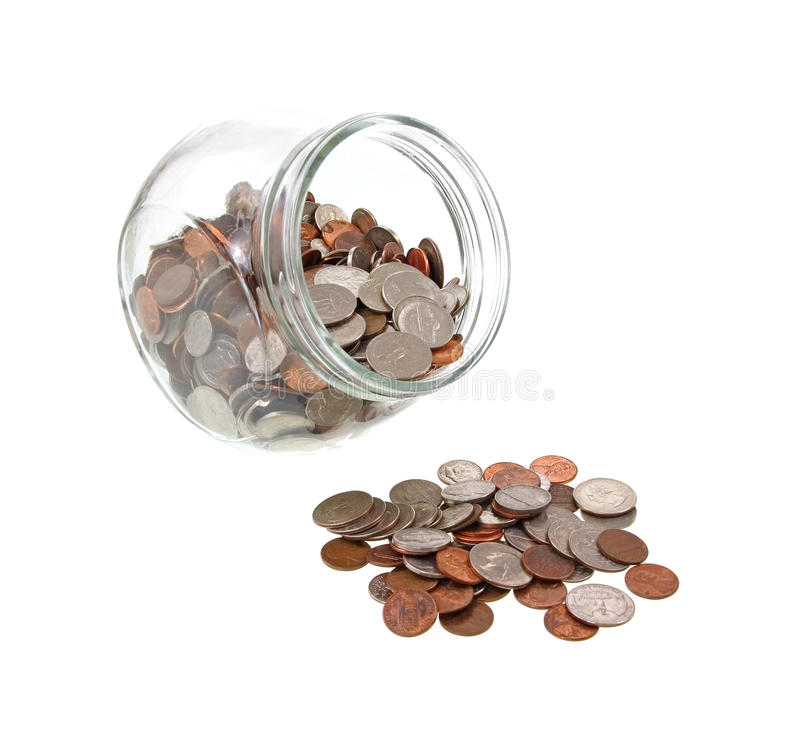 Wide mouth jar and spilled loose change royalty free stock image