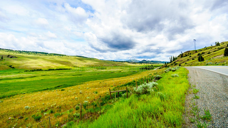 The wide open grasslands and rolling hills of the Nicola Valley. The wide open grasslands of the Nicola Valley along Highway 5A between Kamloops and Merritt royalty free stock image