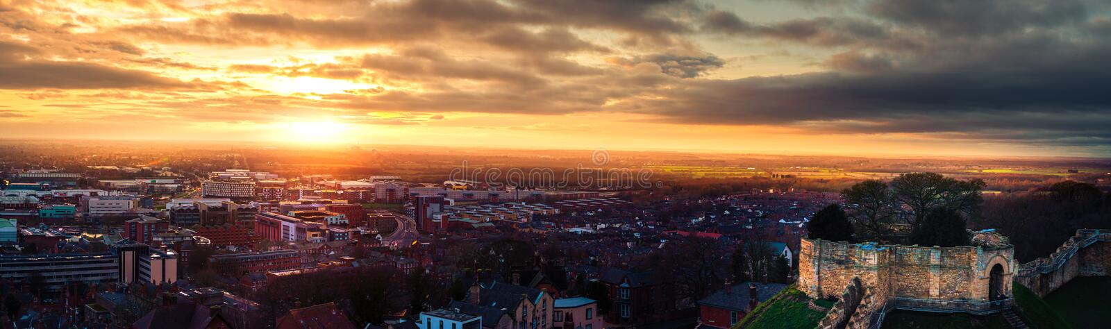 A wide panaromic shot of an epic sunset over Lincoln from the castle walls during the end of the year royalty free stock photos