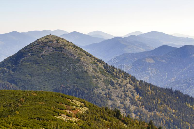 Wide panorama of green mountain hills in sunny clear weather. Carpathian mountains landscape in summer. View of rocky peaks covere stock photos