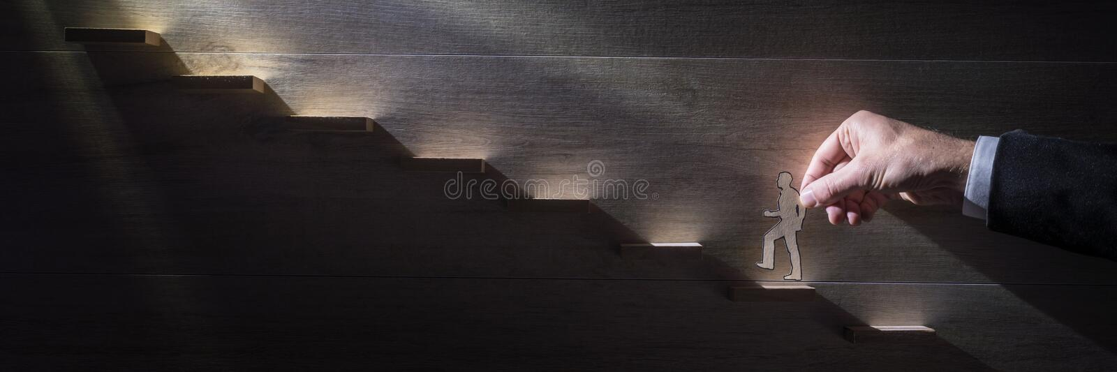 Wide panorama image of a businessman climbing the corporate ladder royalty free stock images