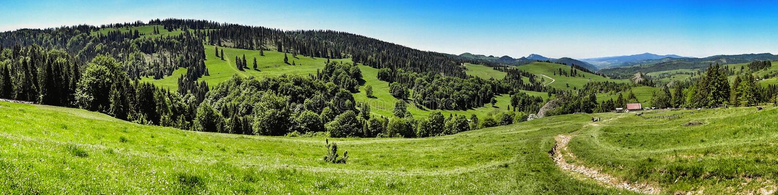 Wide panorama of Pieniny range in southern Poland. Landscape of Pieniny and Gorce mountain range in beskids in Poland. Pieniny Mountains in the south of Poland royalty free stock photos