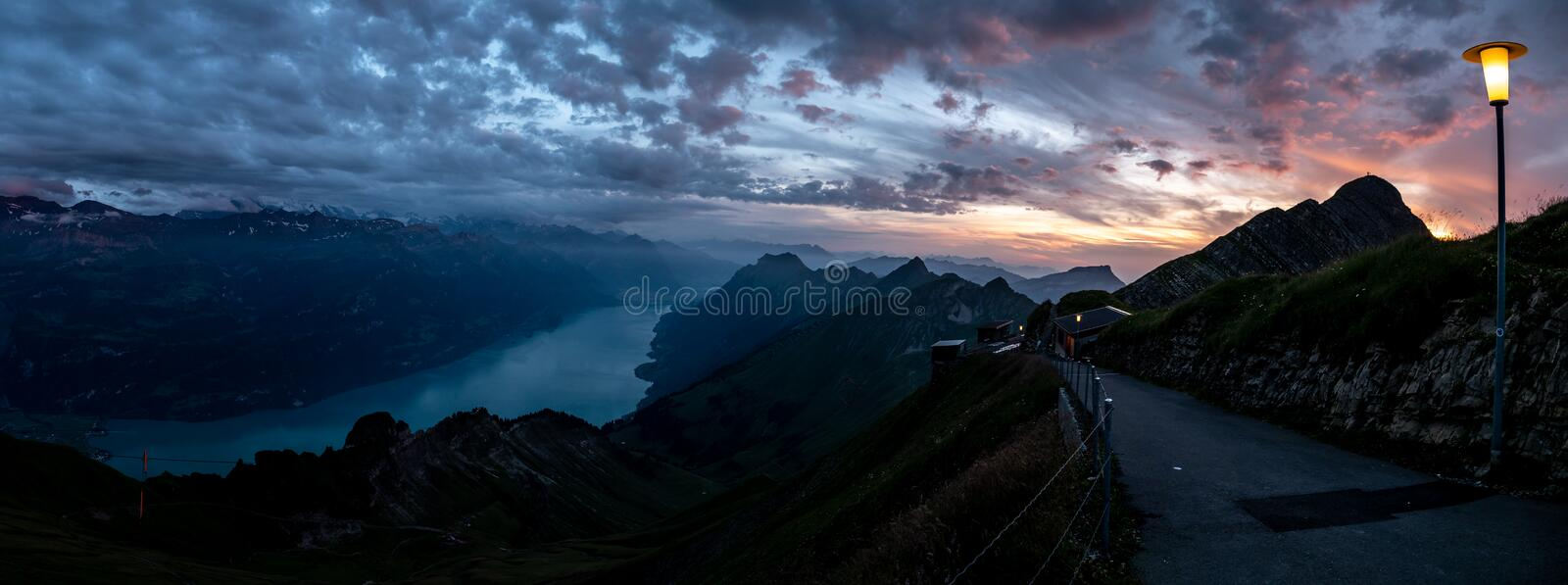 wide panorama view of mountain range during dramatic snuset from the brienzer rothorn in the swiss alps royalty free stock photography
