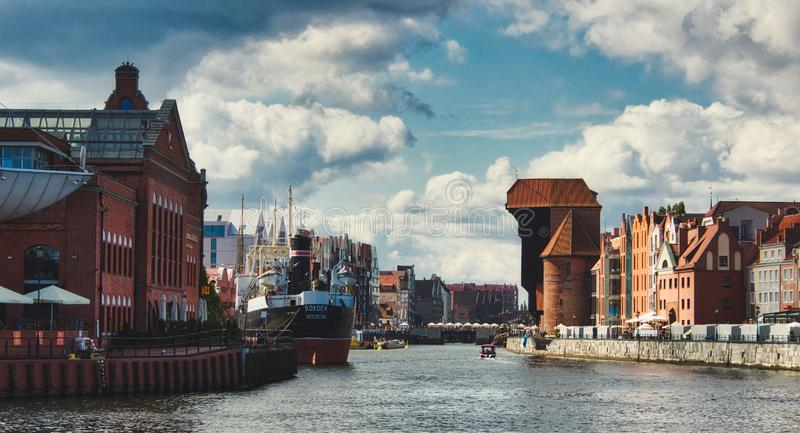Wide panorama view of the river in Gdansk showing the old town crane stock photo