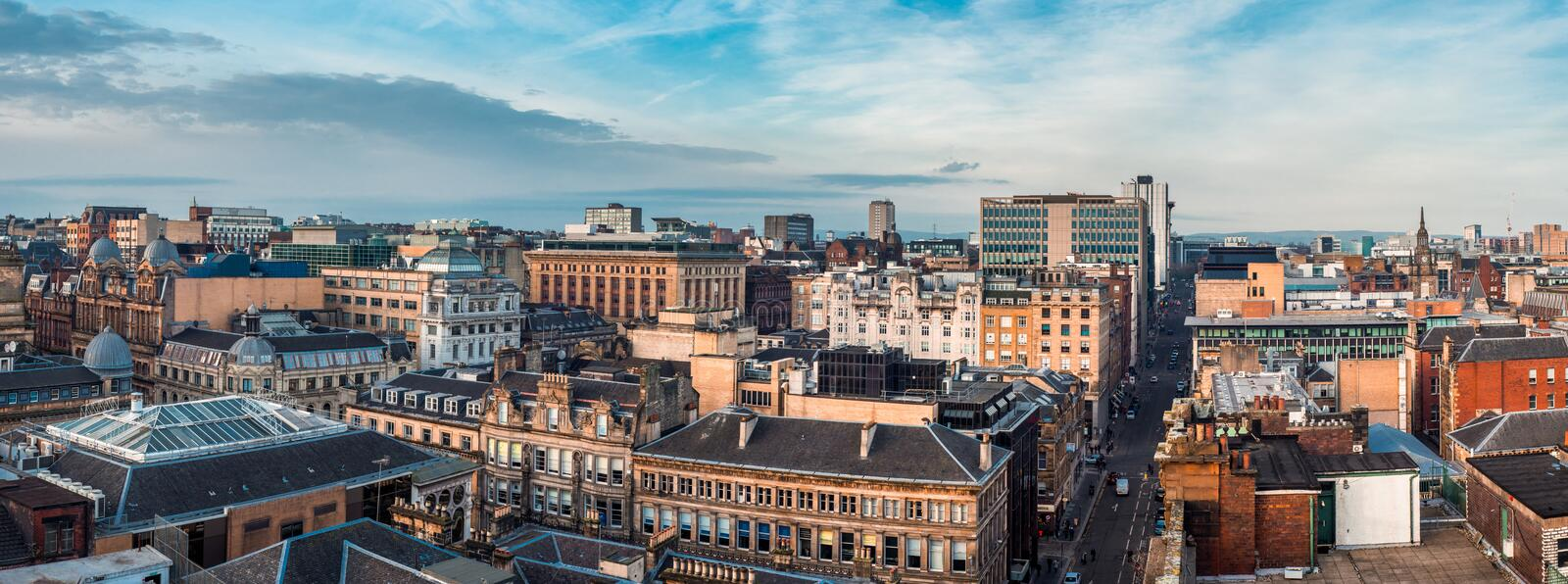 A wide panoramic looking out over buildings and streets in Glasgow city centre. Scotland, United Kingdom. Glasgow / Scotland - February 15, 2019: A wide stock photography