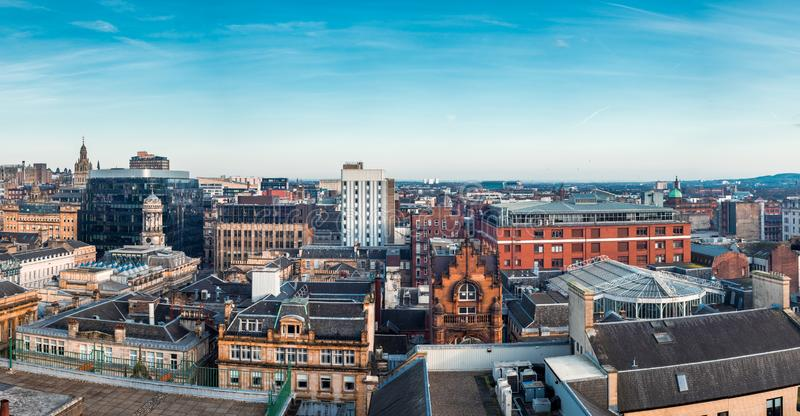 A wide panoramic looking out over buildings in Glasgow city centre. Scotland, United Kingdom. A wide panoramic looking out over old and new buildings and streets stock photography