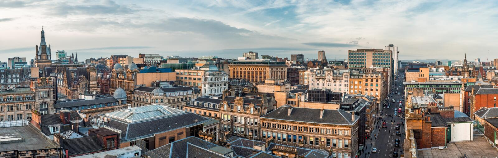 A wide panoramic looking out over old and new buildings and streets in Glasgow city centre. Scotland, United Kingdom. Glasgow / Scotland - February 15, 2019: A royalty free stock photography
