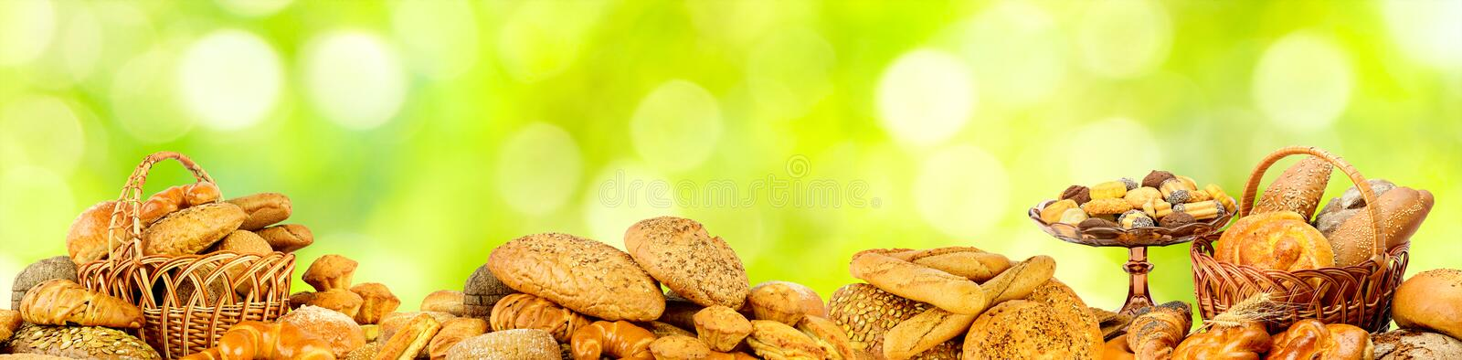 Wide panoramic photo bread products on green background stock photos