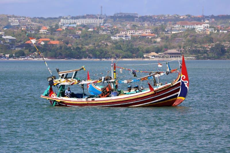 Beautiful picture of fishing boats at Jimbaran Bay at Bali Indonesia, beach, ocean, fishing boats and airport in photo. royalty free stock photography