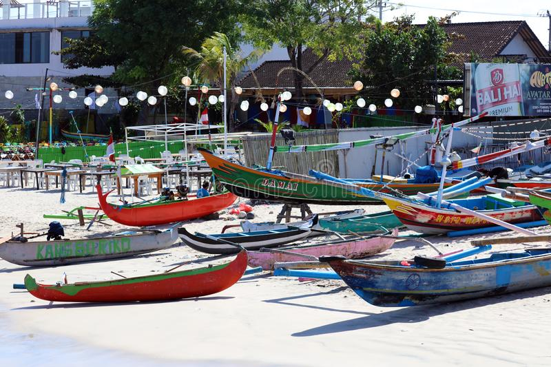 Beautiful picture of fishing boats at Jimbaran Bay at Bali Indonesia, beach, ocean, fishing boats and airport in photo. stock photography