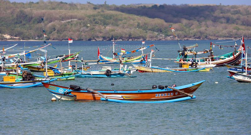 Beautiful picture of fishing boats at Jimbaran Bay at Bali Indonesia, beach, ocean, fishing boats and airport in photo. royalty free stock image