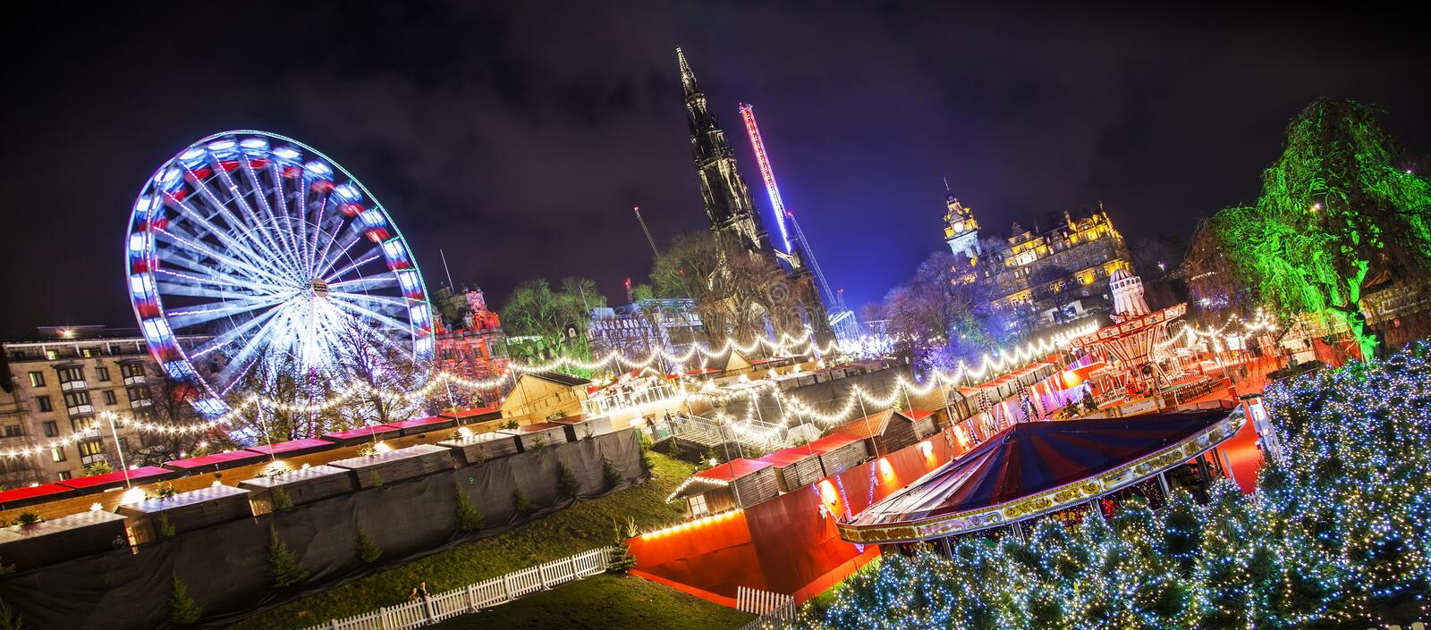 Edinburgh Christmas market. Wide panoramic view of Edinburgh`s Christmas market, rotated photo for more dynamic effect royalty free stock photography
