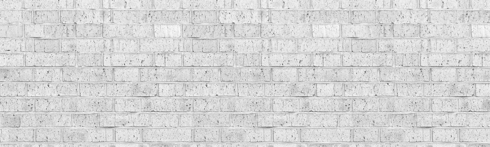 Wide white brick wall texture. Whitewashed shabby brickwork. High key faded vintage background stock photos