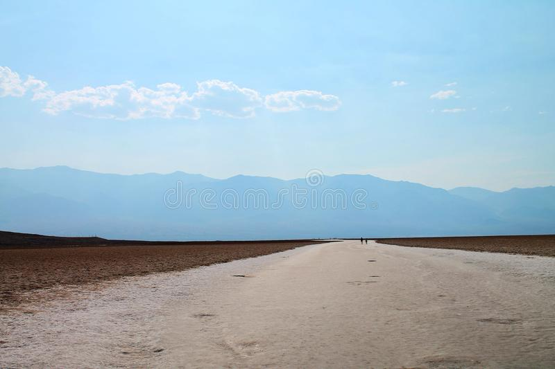 Wide path extending into open salt flat in California royalty free stock photo