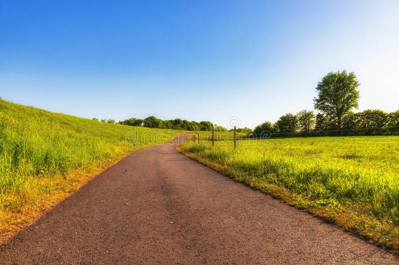A wide path goes up the royalty free stock image